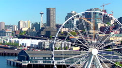 Aerial view of ferris wheel in front of Seattle skyline 6 Arkistovideo