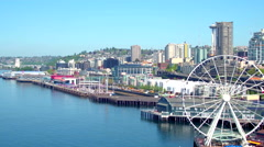Aerial view of ferris wheel in front of Seattle skyline 8 Stock Footage