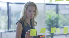 4K Cheerful business colleagues brainstorming for ideas with sticky notes Stock Footage