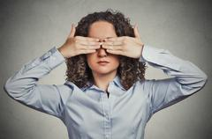 woman closing covering eyes with hands can't look hiding avoiding situation - stock photo