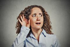 surprised nosy woman eavesdropping - stock photo