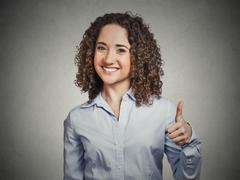 Woman student being excited giving showing thumbs up hand gesture Stock Photos