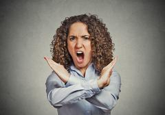Angry screaming woman making showing stop gesture - stock photo
