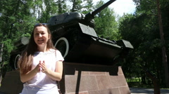 Battle tanks - military exercise - model claps her hands - stock footage