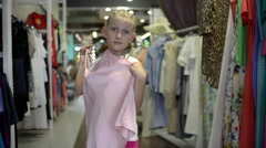 Child Girl Get Shopping at the Clothes Store - posing in front of mirror Stock Footage