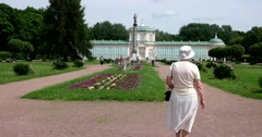 The Orangery. A woman walks in the Park of Kuskovo. Stock Footage