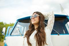 smiling young hippie woman in minivan car - stock photo