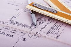 Drawing equipment with detailed architects house plans - stock photo