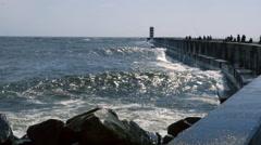 Ocean wave hitting rocks with dramatic water splashing Stock Footage