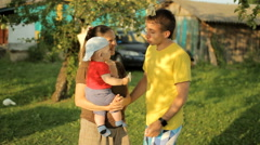 Happy family playing in the garden with clothespins. Mom, dad, son, smile and - stock footage