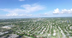 North Palm Beach Lighthouse Drive West Pan at birds eye view Stock Footage