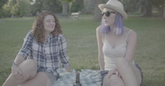 Girls laughing in the park Stock Footage