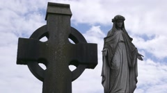 Glasnevin Cemetery Dublin, Ireland Grounds. Celtic Cross & Virgin Mary Headstone Stock Footage
