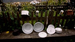 Old dishes in a mountian village Stock Footage