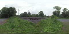 360 VR Two trains and empty road in the countryside of Frankfurt, Germany Stock Footage