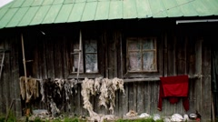 Old hut in mountians with drying wool on a back Stock Footage