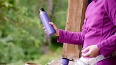 Girl shake a tea in a tea pot in a mountain's hut Stock Footage