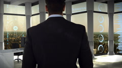 Businessman in office with futuristic city background Stock Footage