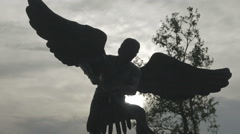 Close-up of angel statue with sun in background - stock footage