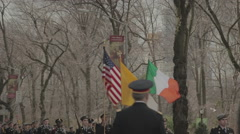 American and Irish flags in St Patrick's Day Parade, New York City Stock Footage