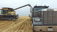 New Holland Combine and Semi Truck Side View Stock Footage