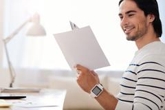 Handsome smiling man working in the office - stock photo