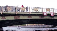 Pleasure Boat Swim Under The Bridge. Passengers Point Of View - stock footage