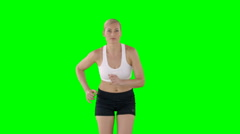 Sportswoman making physical exercise Stock Footage