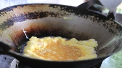 Cooking omelet eggs boiled oil in pan Stock Footage