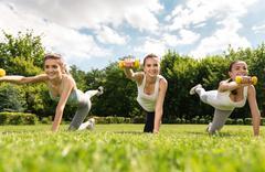 Positive smiling women doing sport activities - stock photo