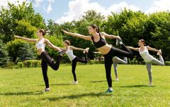 Cheerful sporty woman doing sport exercises Stock Photos