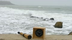 Compass and telescope spyglass on sand. Sunken barge, bollard and bitt Stock Footage