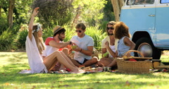 Group of hipster friends sitting and having fun together Stock Footage