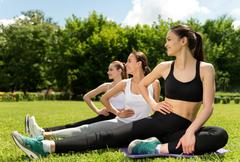 Joyful sporty women doing sport activities Stock Photos