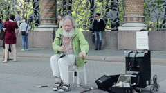 Bearded White-haired Old Man Gave A Marvelous Concert On The Street Stock Footage