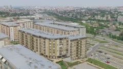 Aerial slow motion over newly built settlement. Above roofs of new buildings. Stock Footage