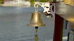 Closer look of the bell on the travelling boat Stock Footage