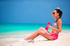 Active fit young woman in her sportswear during beach vacation Stock Photos