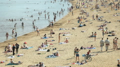 A crowded beach in summer in Velikiy Novgorod Stock Footage