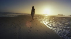 Young woman walking beach at sunset Port Orford OR Stock Footage