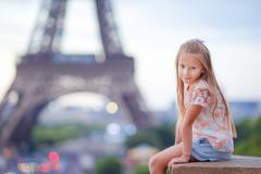 Cute little girl background the Eiffel tower during summer vacation in Paris - stock photo