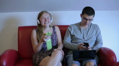 Happy couple is spending time together with gadget Stock Footage