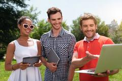 Modern youth relaxing outdoors Stock Photos
