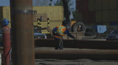 Construction worker attaching a foundation pile Stock Footage