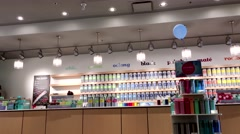 Motion of DAVIDsTEA store in Lougheed Town Centre mall Stock Footage