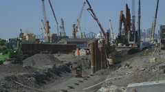 Excavator digging a pit for foundation piles Stock Footage