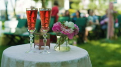 Wedding Ceremony Table with champagne and flowers - stock footage