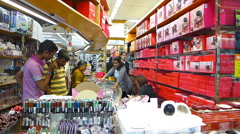 Tourists consumers shopping at Singapore Little India Mustafa Center Centre  Stock Footage