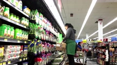 Produce clerk stocking lettuce salad in Walmart store - stock footage