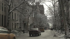 Cars Drive Down New York Street as Snow Melts off Trees Stock Footage